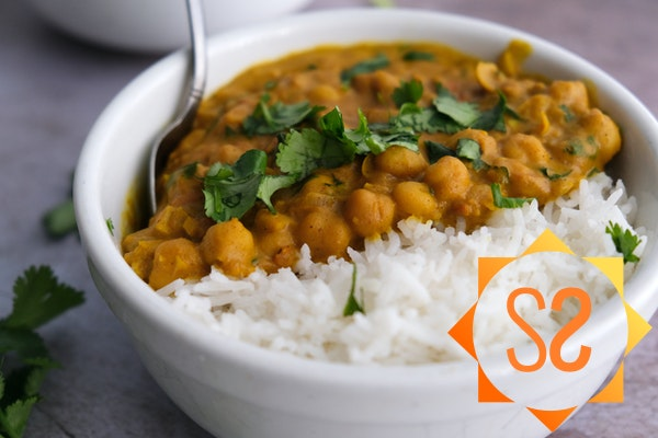 Chickpea curry in a bowl with rice
