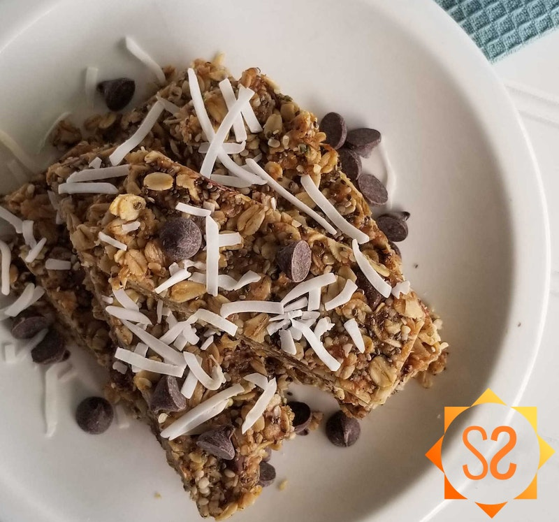 Chocolate peanut butter granola bars with coconut and chocolate chips on top