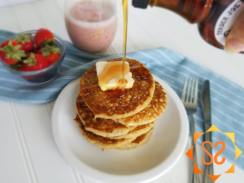 """Vegan """"buttermilk"""" pancakes with syrup and strawberries"""