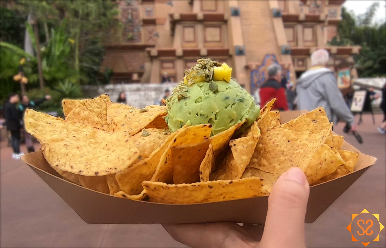 Guacamole and chips with mango and pumpkin seeds