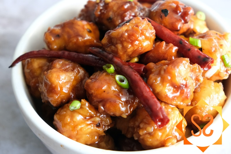 General Tso's Tofu with green onions and red chiles