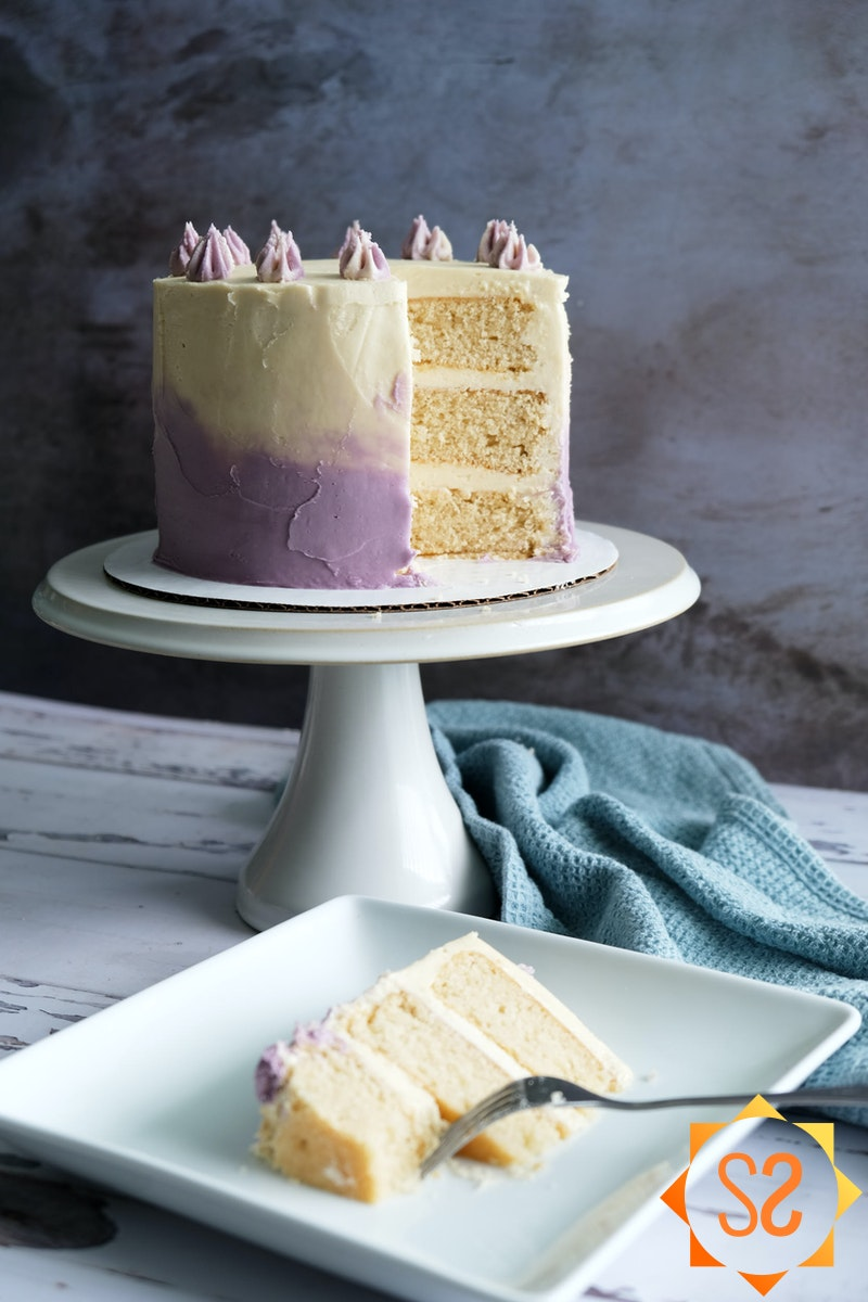 vegan vanilla cake with slice in foreground