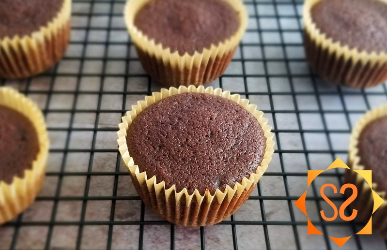 Chocolate cupcakes on a cooling rack