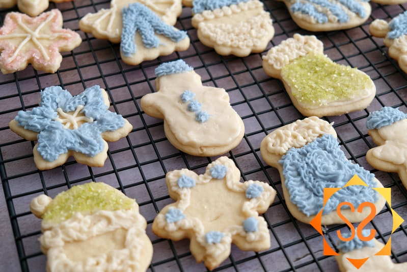 Iced sugar cookies on a cooling rack