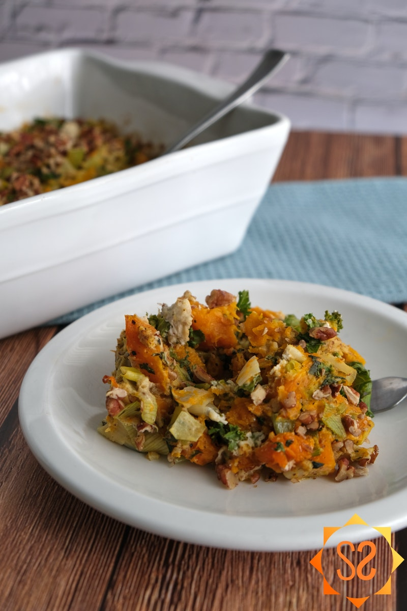 Butternut squash on a plate with casserole in background
